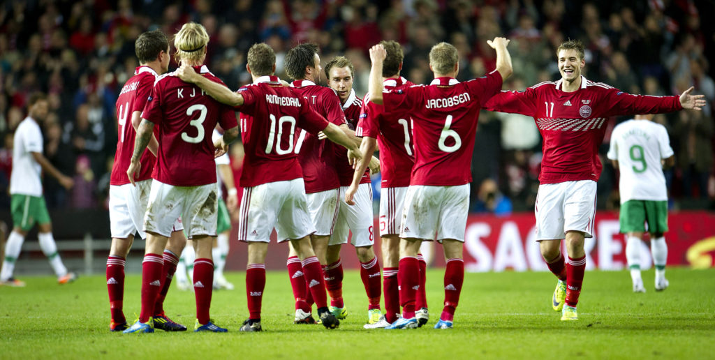 Denmark's Nicklas Bendtner (R) celebrates with teammates after they beat Portugal in their Euro 2012 Group H qualifying soccer match in Copenhagen October 11, 2011. REUTERS/Marie Hald/Scanpix (DENMARK - Tags: SPORT SOCCER) NO COMMERCIAL SALES. THIS IMAGE HAS BEEN SUPPLIED BY A THIRD PARTY. IT IS DISTRIBUTED, EXACTLY AS RECEIVED BY REUTERS, AS A SERVICE TO CLIENTS. DENMARK OUT. NO COMMERCIAL OR EDITORIAL SALES IN DENMARK
